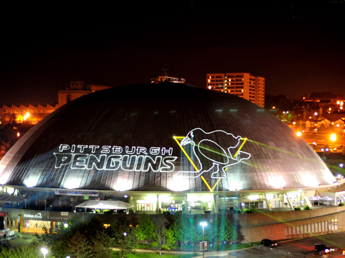 NHL Team Pittsburgh Penguins uses the most powerful full-color entertainment lasers in the WORLD ( 85W total! ) to cover the dome of the Mellon Arena in downtown Pittsburgh during the 2009 Stanley Cup Playoff Games. This continued during the Stanley Cup Finals, when Lightwave moved from the Arena roof and projected lasers onto several of downtown Pittsburgh's tallest buildings.