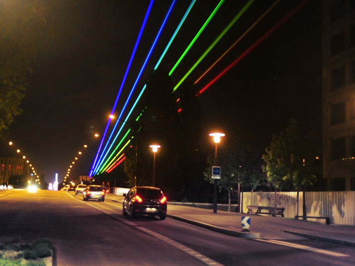 "When artist Yvette Mattern wanted to display her ""Global Rainbow"" art project in Nantes, France, she turned to Lightwave International to provide the laser skills necessary to bring her vision to life. Utilizing custom-made optics, Lightwave's skilled technicians created a laser rainbow visible from over 60 kilometers away from the city!"